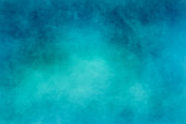 Abstract modern painting . Dry brush painted paper , canvas , wall . Textured background in blue and cyan tones.