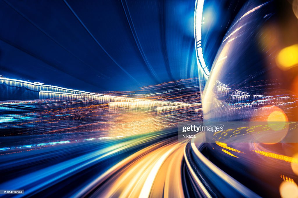 Abstract motion blurred city lights : Stock Photo