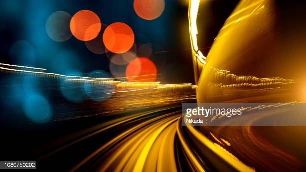abstract motion-blurred view from a moving train - monorail stock pictures, royalty-free photos & images