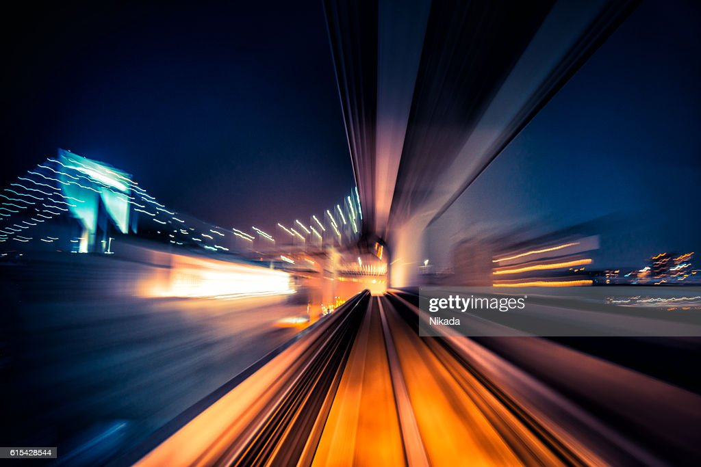 abstract motion-blurred view from a moving train : Stock Photo