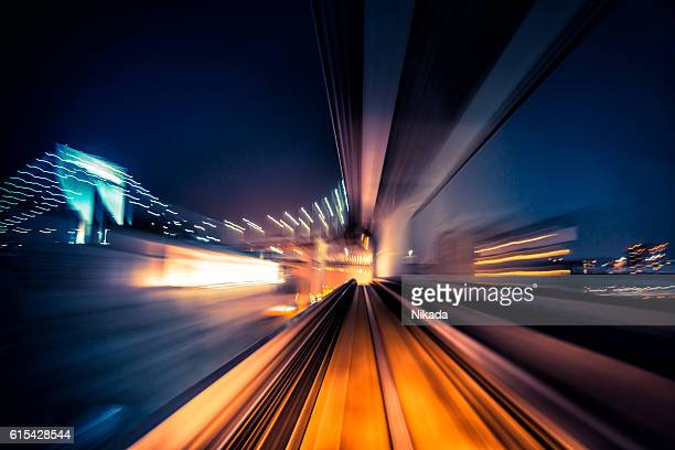 abstract motion-blurred view from a moving train - motion stock pictures, royalty-free photos & images