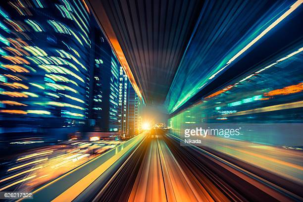 abstract motion-blurred view from a moving train - motion blur stock photos and pictures