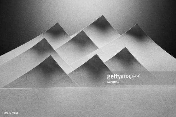 abstract mountain shape paper - color climax stock pictures, royalty-free photos & images