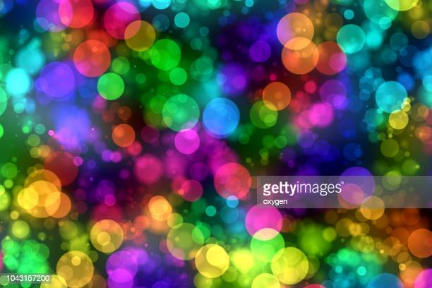abstract multicolored bokeh sparkling spray circle - multi colored background stock pictures, royalty-free photos & images