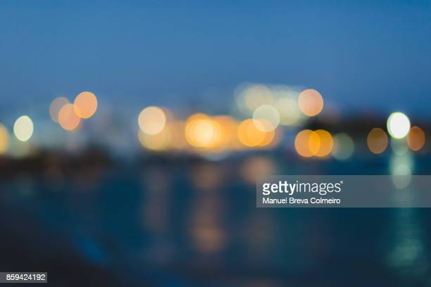 abstract multicolored defocused lights - illuminated stock pictures, royalty-free photos & images
