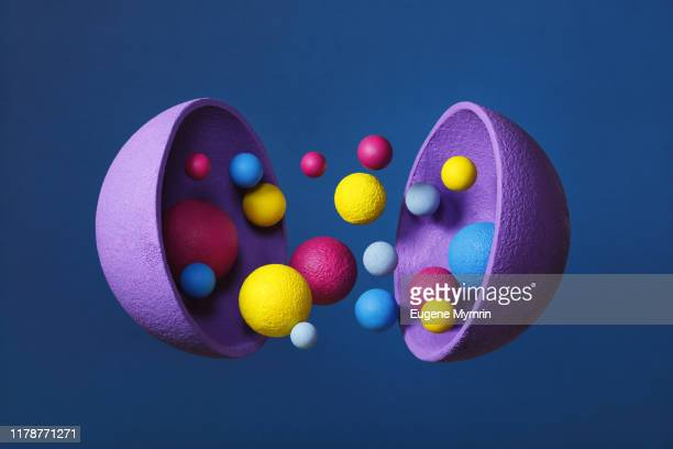 abstract multi-colored objects levitation in mid air on blue background - individuality stock pictures, royalty-free photos & images