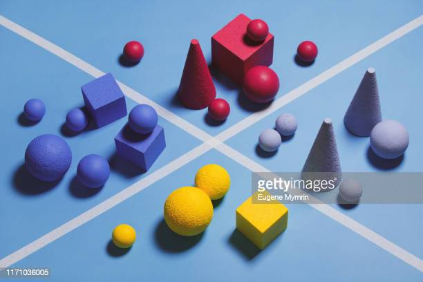 abstract multi-colored objects on blue background - organized group stock pictures, royalty-free photos & images