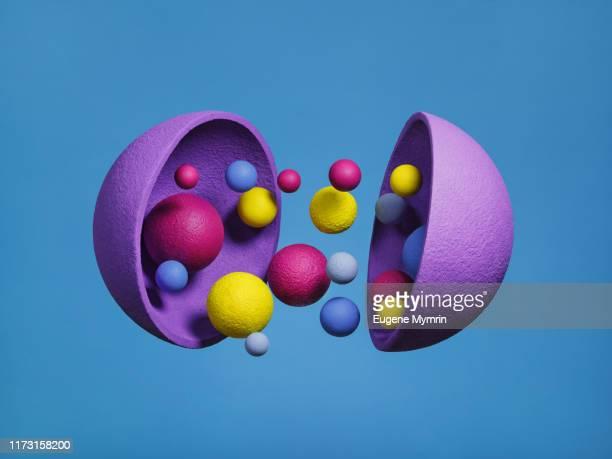 abstract multi-colored objects on blue background - esfera imagens e fotografias de stock