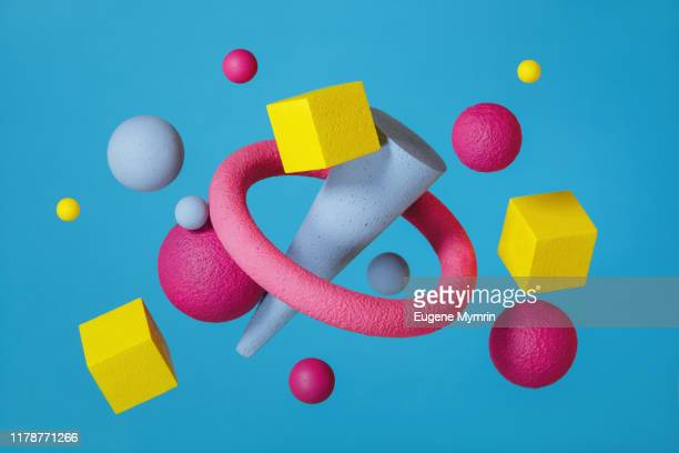 abstract multi-colored objects on blue background - man made object stock pictures, royalty-free photos & images