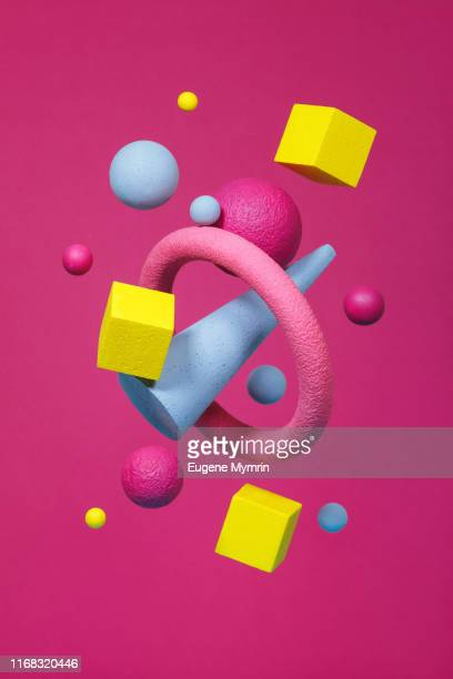 abstract multi-colored objects on pink background - shape stock pictures, royalty-free photos & images