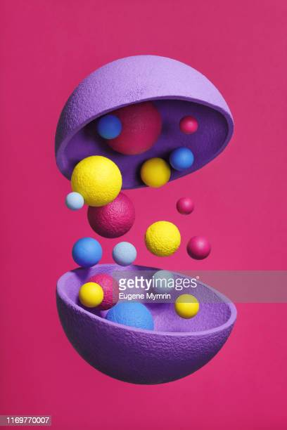 abstract multi-colored objects on pink background - dreidimensional stock-fotos und bilder