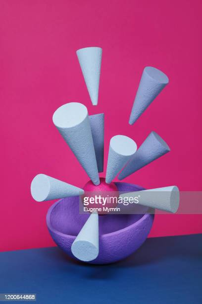 abstract multi-colored objects on pink background - cone shaped objects stock pictures, royalty-free photos & images