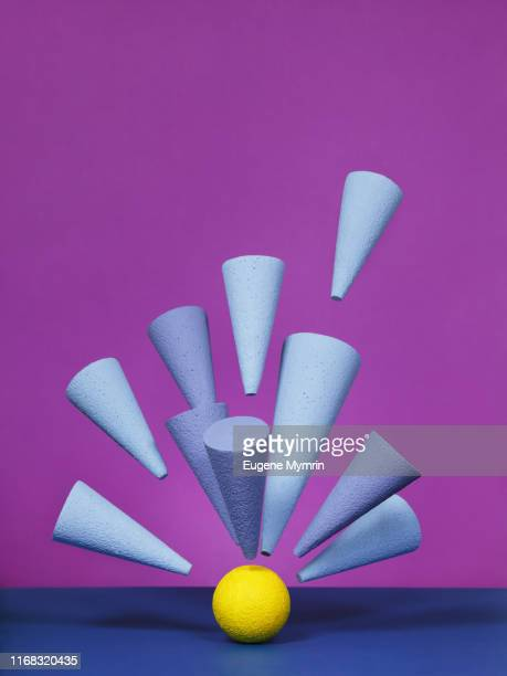 abstract multi-colored objects on purple background - punto focale foto e immagini stock