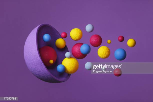 abstract multi-colored objects on purple background - global communications stock pictures, royalty-free photos & images