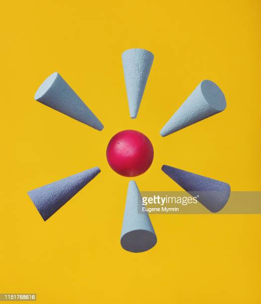 abstract multi-colored objects on yellow background - 狙う ストックフォトと画像