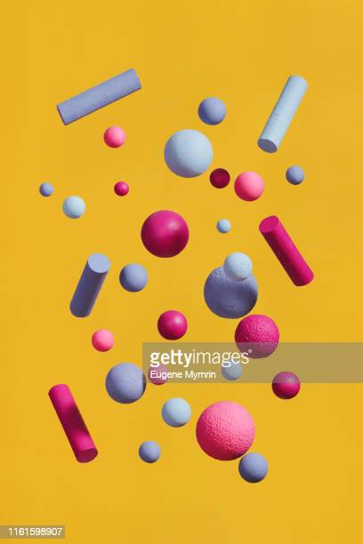 abstract multi-colored spheres on yellow background - three dimensional stock pictures, royalty-free photos & images
