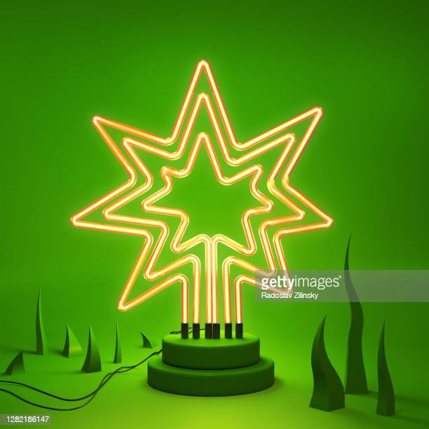 abstract neon lamp yelllow star shape background object - star shape stock pictures, royalty-free photos & images