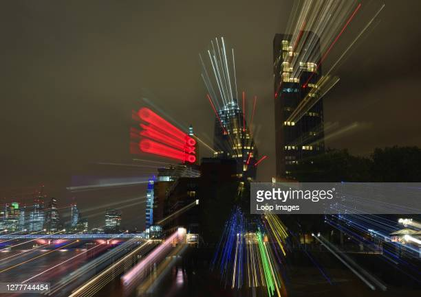 Abstract nighttime image of London's South Bank and City with light trails.