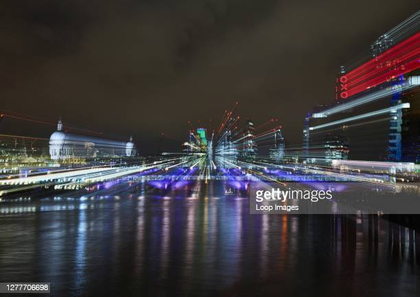 Abstract nighttime view of London including St Paul's Cathedral and the City with light trails.