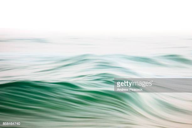 abstract ocean patterns and color. - emerald green stock pictures, royalty-free photos & images
