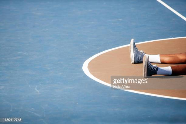 abstract of basketball player's feet on central part of basketball court - line art stock pictures, royalty-free photos & images