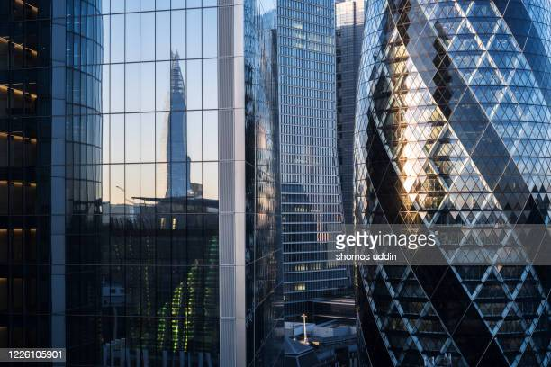 abstract of modern office buildings in london financial district - construction industry stock pictures, royalty-free photos & images