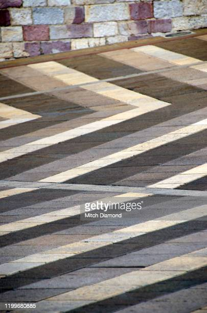 abstract of the lower plaza of assisi italy - assis ストックフォトと画像