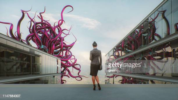 abstract office businesswoman with alien tentacles - tentacle stock pictures, royalty-free photos & images