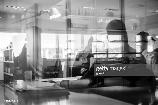 abstract office workers in the meeting - monochrome stock pictures, royalty-free photos & images