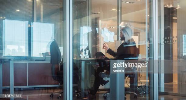 abstract office workers in the meeting - glass magazine stock photos and pictures