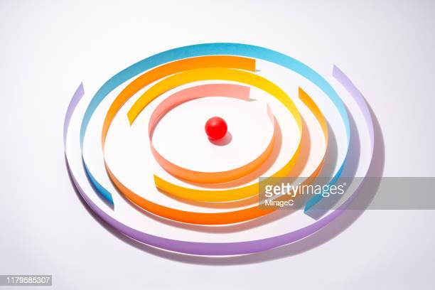 abstract paper wall surrounding red sphere - surrounding stock pictures, royalty-free photos & images