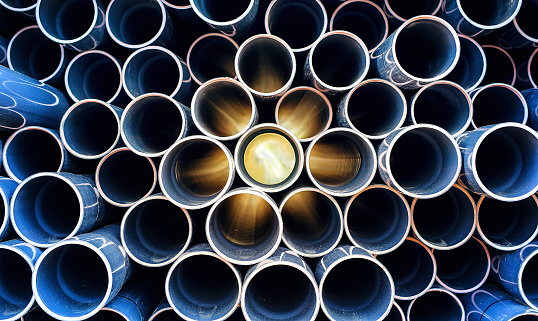 abstract pattern of aged pvc pipe with sun lights 836200296