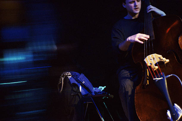 Abstract photo of a jazz musician playing the bass at a nightclub