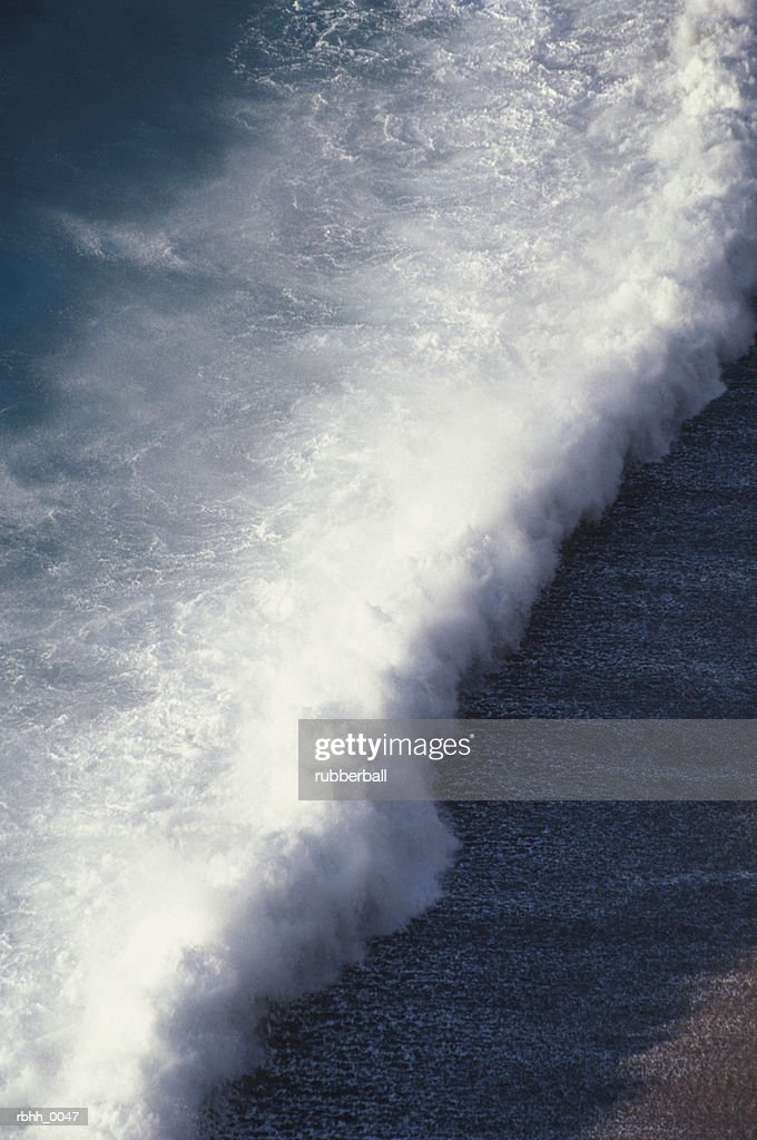 abstract photograph of a waves crashing over a beach : Stockfoto