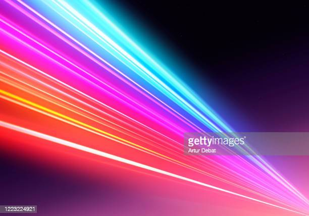 abstract picture of colorful light trails crossing twilight sky with fast motion. - success stock pictures, royalty-free photos & images