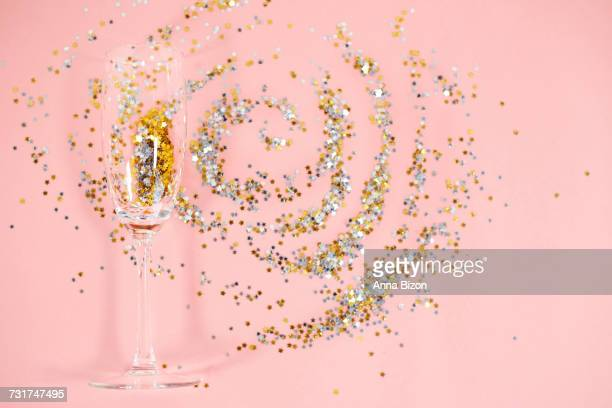 Abstract picture of drinking glass and confetti. Debica, Poland
