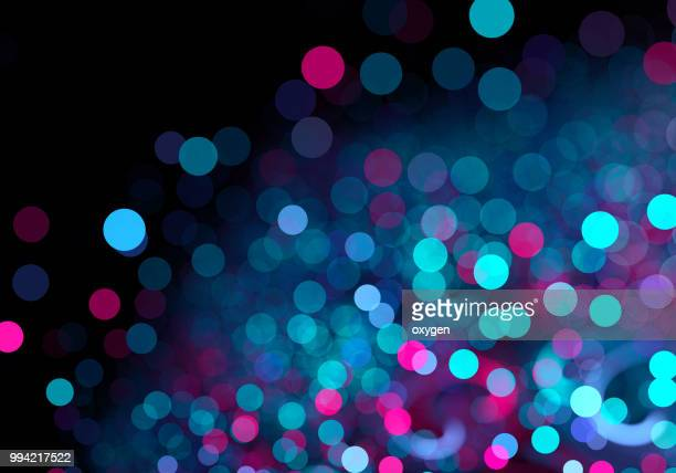 abstract pink and blue spotted bokeh background - licht natuurlijk fenomeen stockfoto's en -beelden