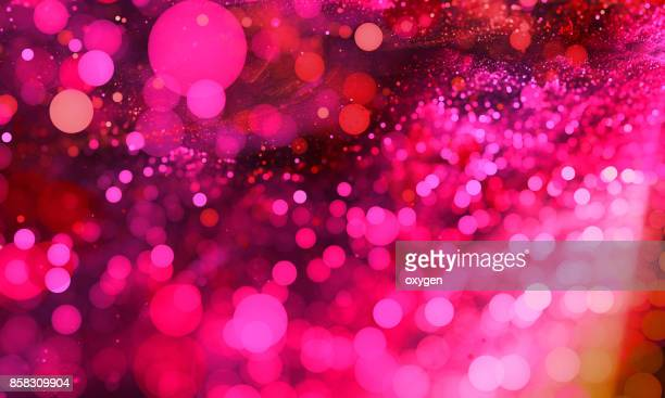 abstract pink bokeh sparkling spray circle - christmas party stock photos and pictures