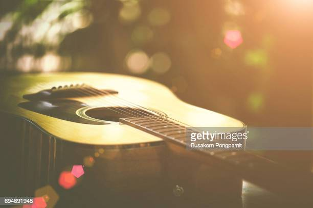 abstract portrait of a guitar on bokeh background. - acoustic guitar stock pictures, royalty-free photos & images
