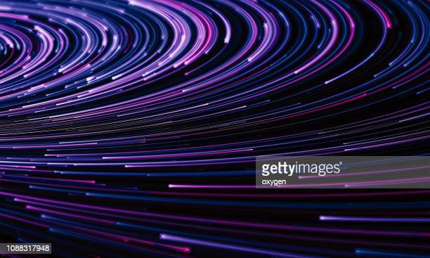 abstract purple background with optical fibers - velocidad fotografías e imágenes de stock