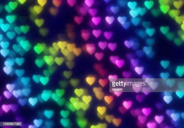 abstract rainbow hearts bokeh on black background - february background stock pictures, royalty-free photos & images