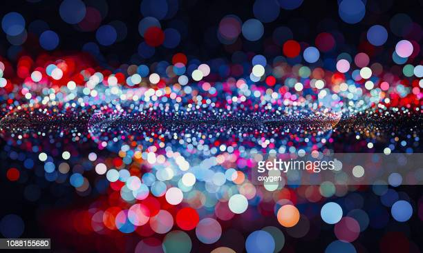 abstract red and blue bokeh sparkling spray circle - image en couleur photos et images de collection