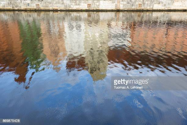 Abstract reflections of Main Town's old colorful buildings on the Motlawa River in Gdansk, Poland.