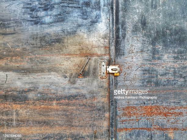 abstract rusty door - weathered stock pictures, royalty-free photos & images