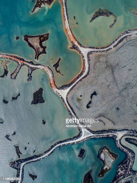 abstract salt pools as seen from directly above, cadiz, spain - andalucia fotografías e imágenes de stock