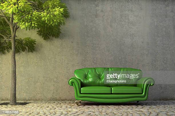 Abstract scene with couch on a side walk