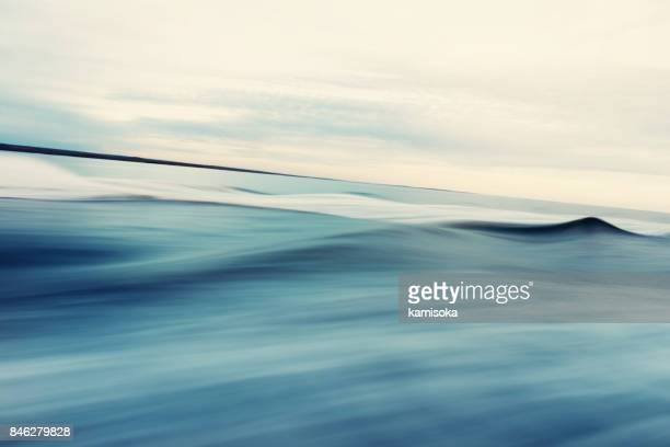 abstract sea and sky background - tide stock pictures, royalty-free photos & images