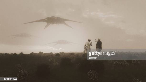 abstract senior couple waving at flying ufos - worshipper stock pictures, royalty-free photos & images