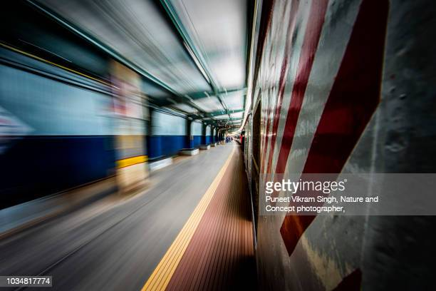 abstract shot of a view from the footboard of a local train of mumbai - passeren stockfoto's en -beelden