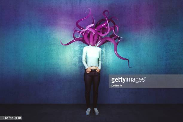 abstract tentacle woman against concrete wall - medusa stock pictures, royalty-free photos & images
